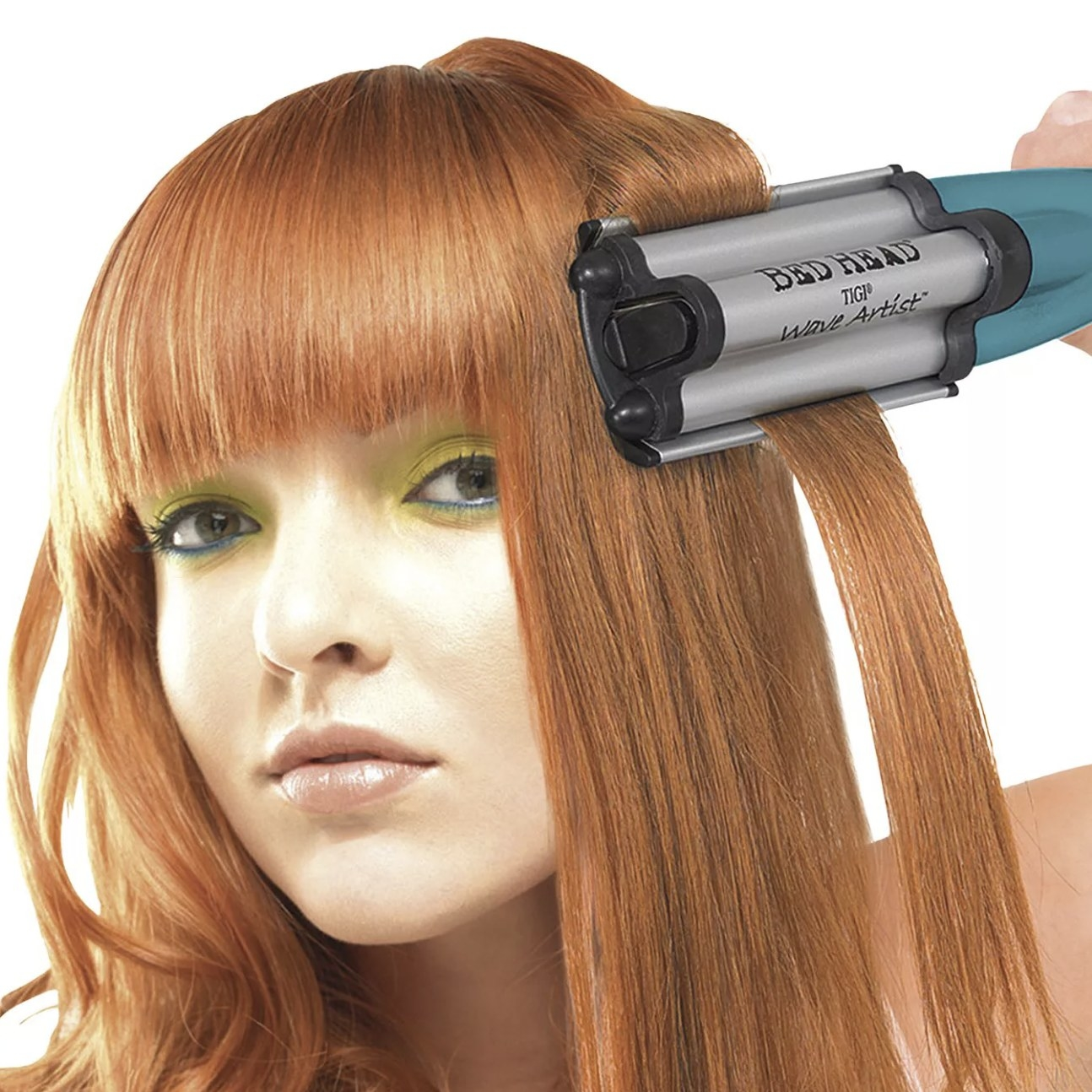 Model is using the waver on their long red hair
