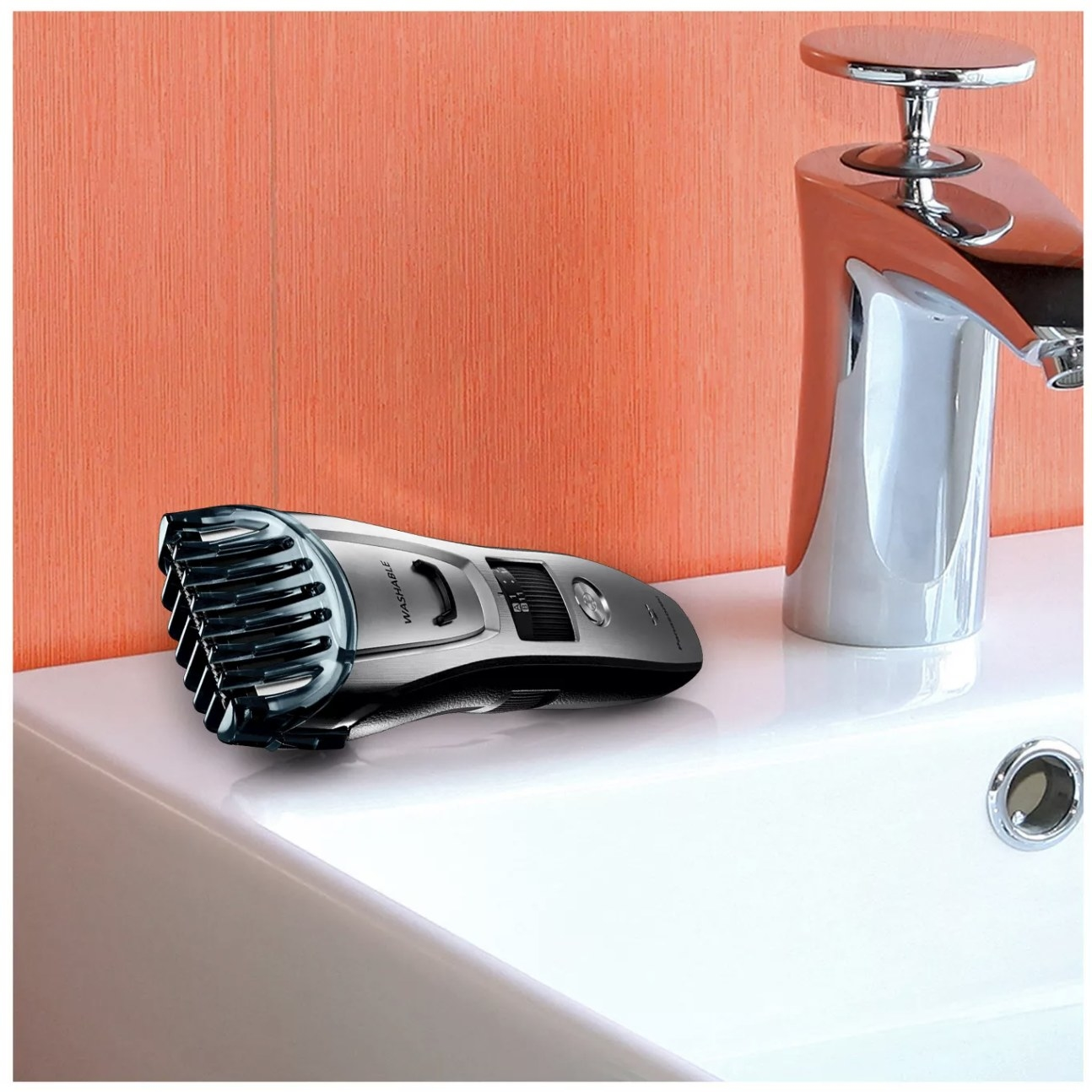 Beard trimmer sits on top of the bathroom sink