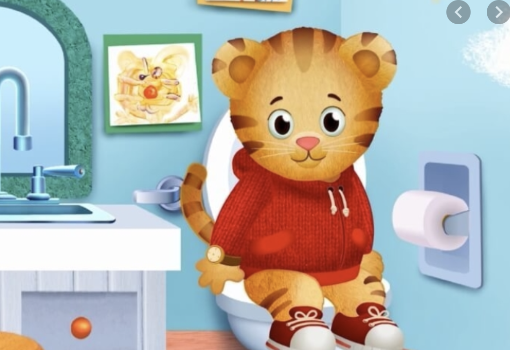 Daniel Tiger sitting on the potty.