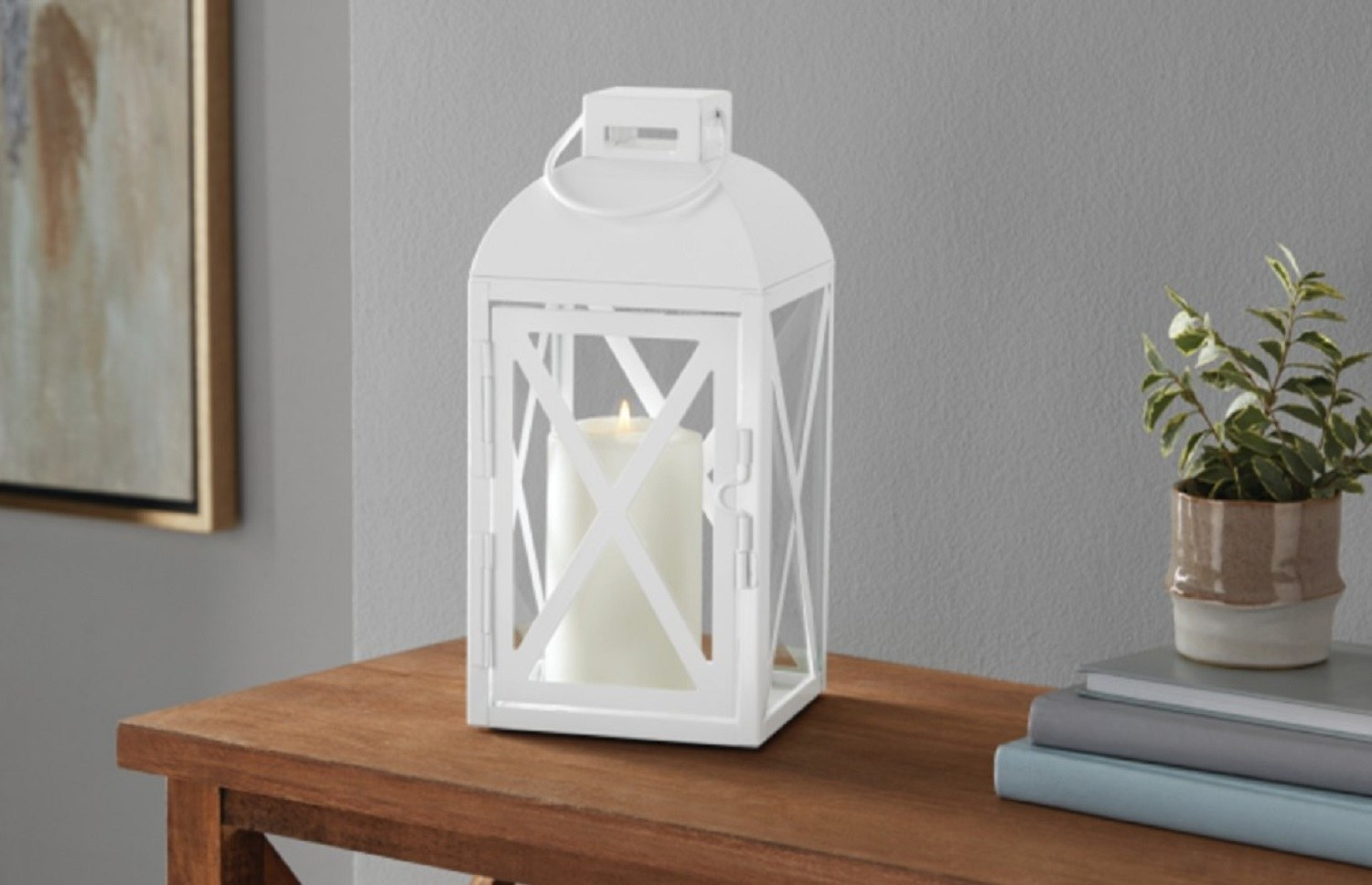 The lantern in white holding a candle