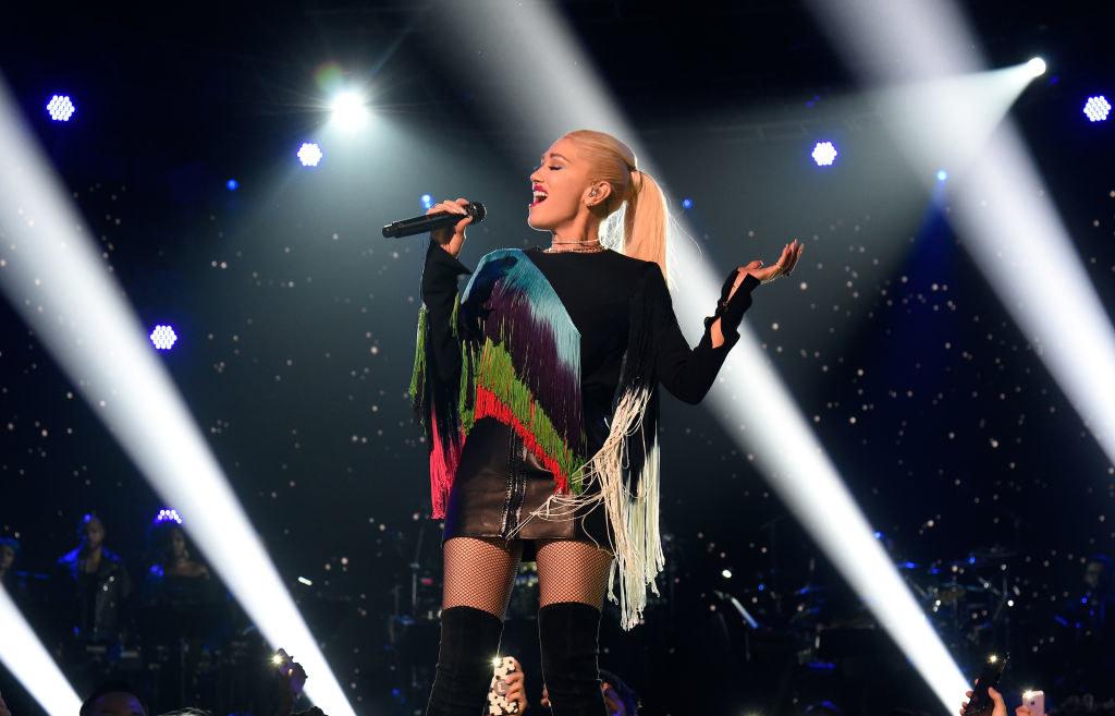 Gwen singing onstage