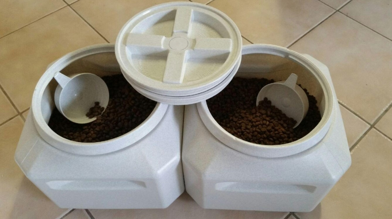The reviewer's image of the vault pet storage container with pet food and scoopers