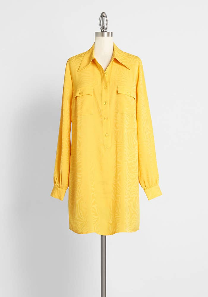 The bright yellow dress with a collar and two front pockets