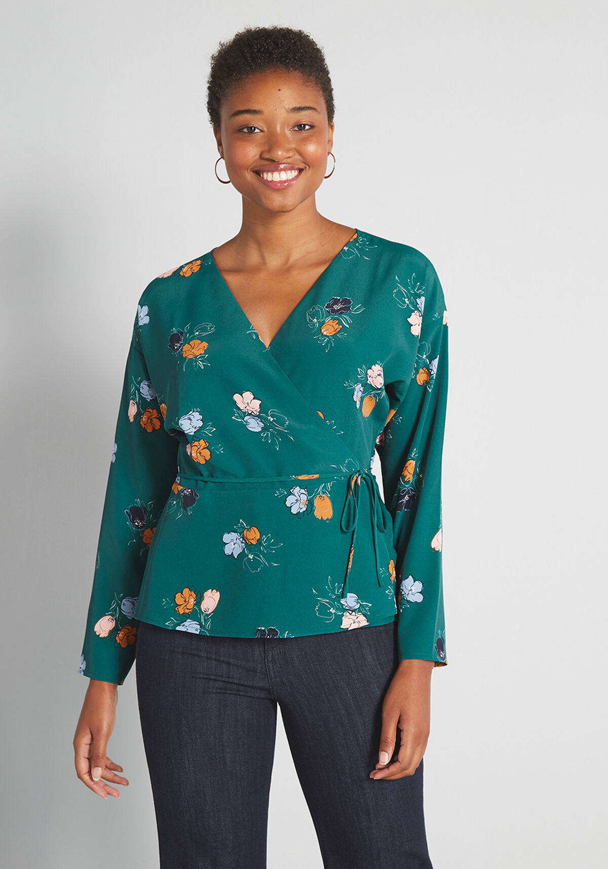 The top in dark green with blue, beige, and orange flowers and a tie waist