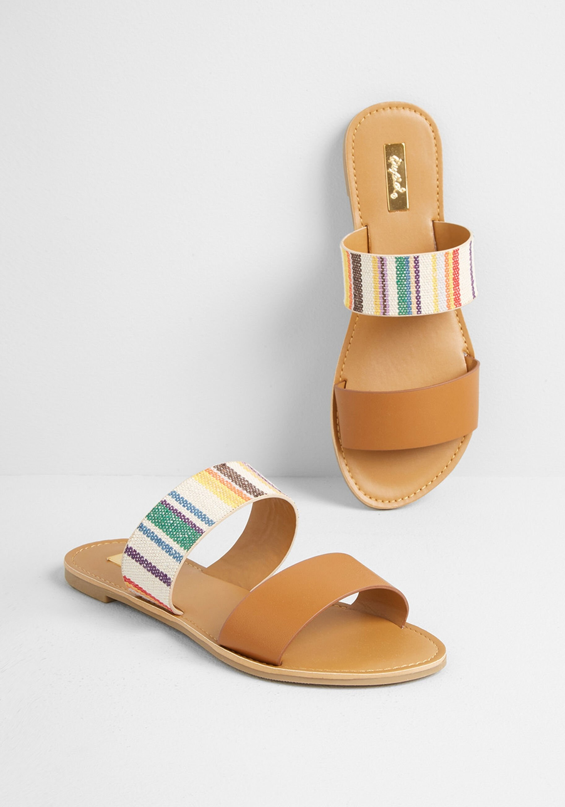 The backless sandals with two front bands, one band has rainbow stripes