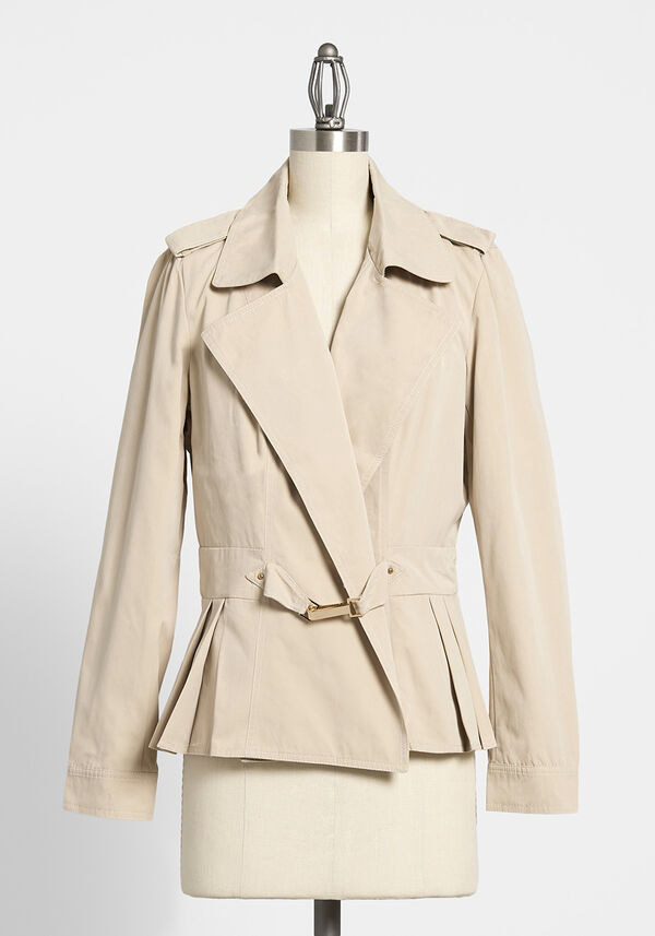 The nude colored jacket with colors and a buckle clasp in front
