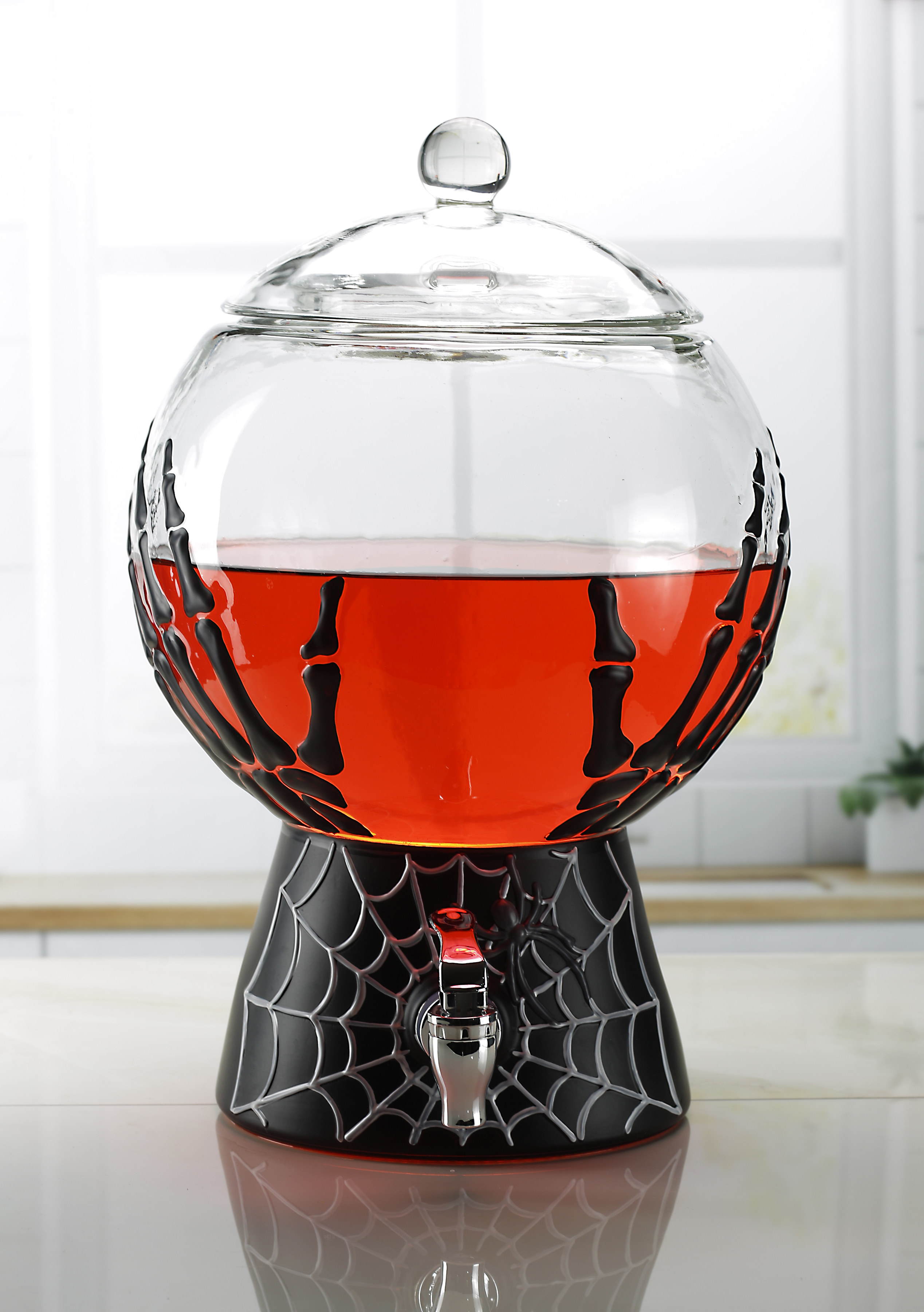 The dispenser filled with a red drink
