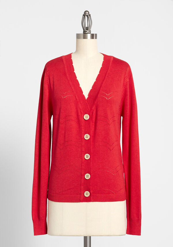The v-neck cardigan in a bright red with beige buttons on the front