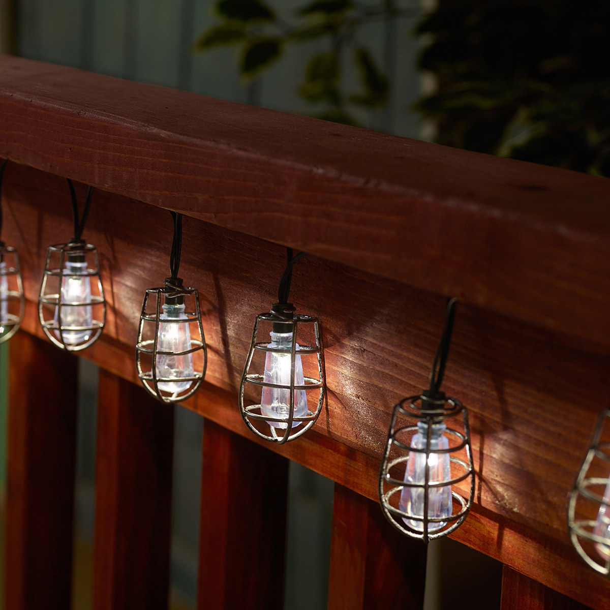 The string lights illuminated on a deck