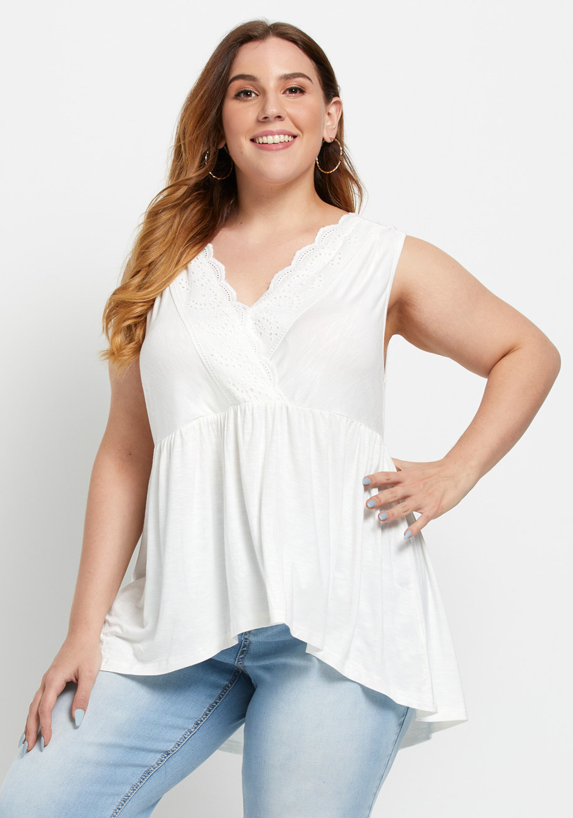 A model wearing the v-neck tank top with eyelet trim by the neckline in white