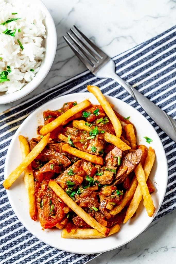 Peruvian beef stir fry over French fries.