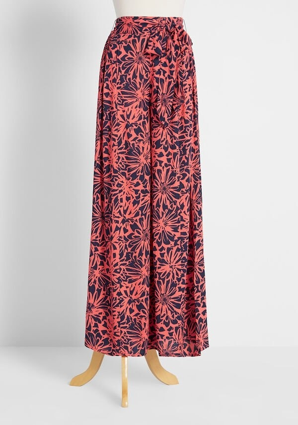 The pants with a black and pink floral pattern
