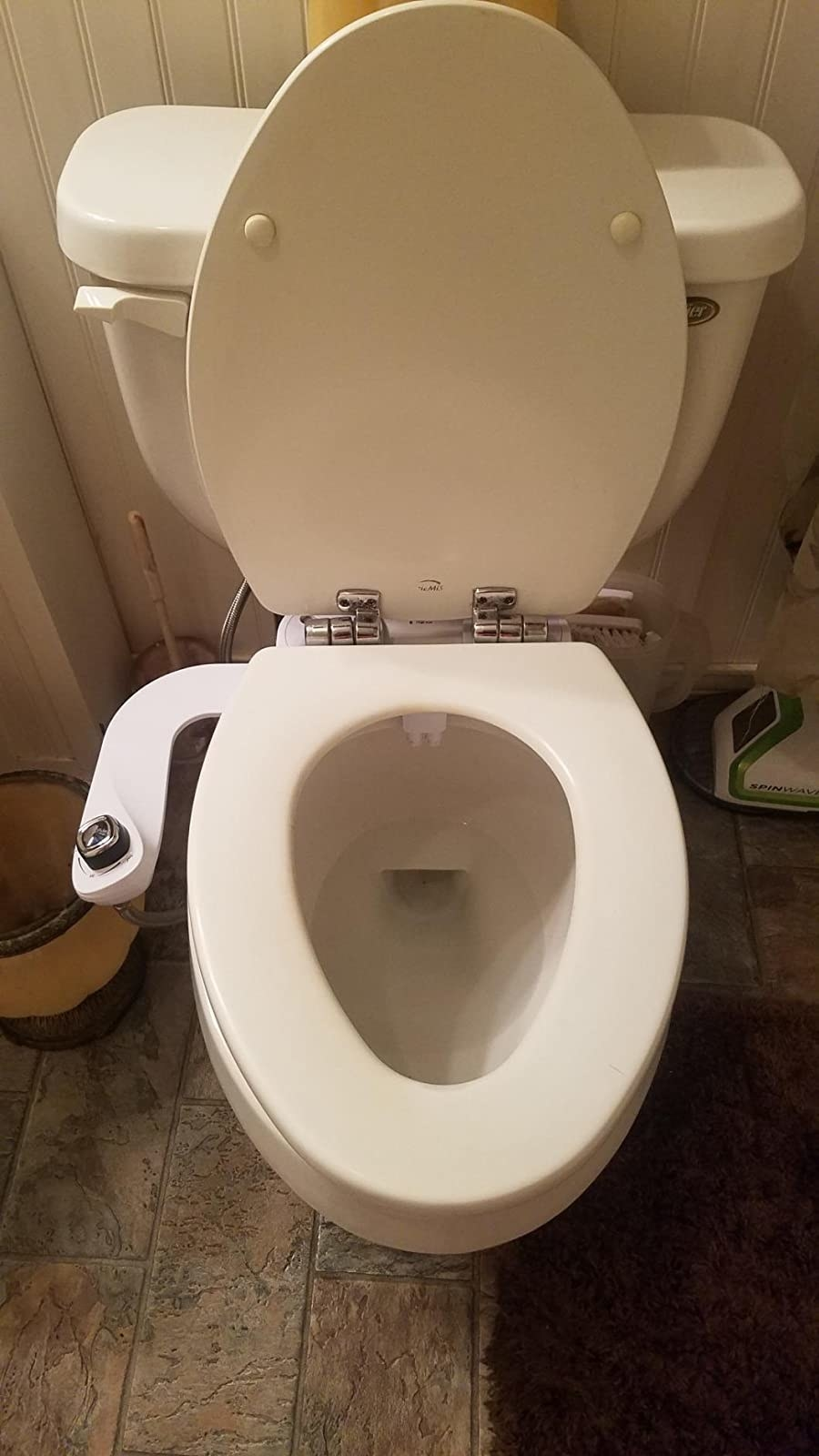The bidet attached to a toilet