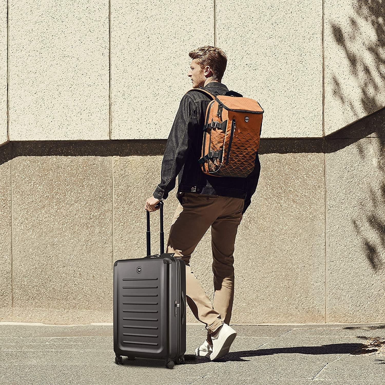 A model rolling the black hardside suitcase