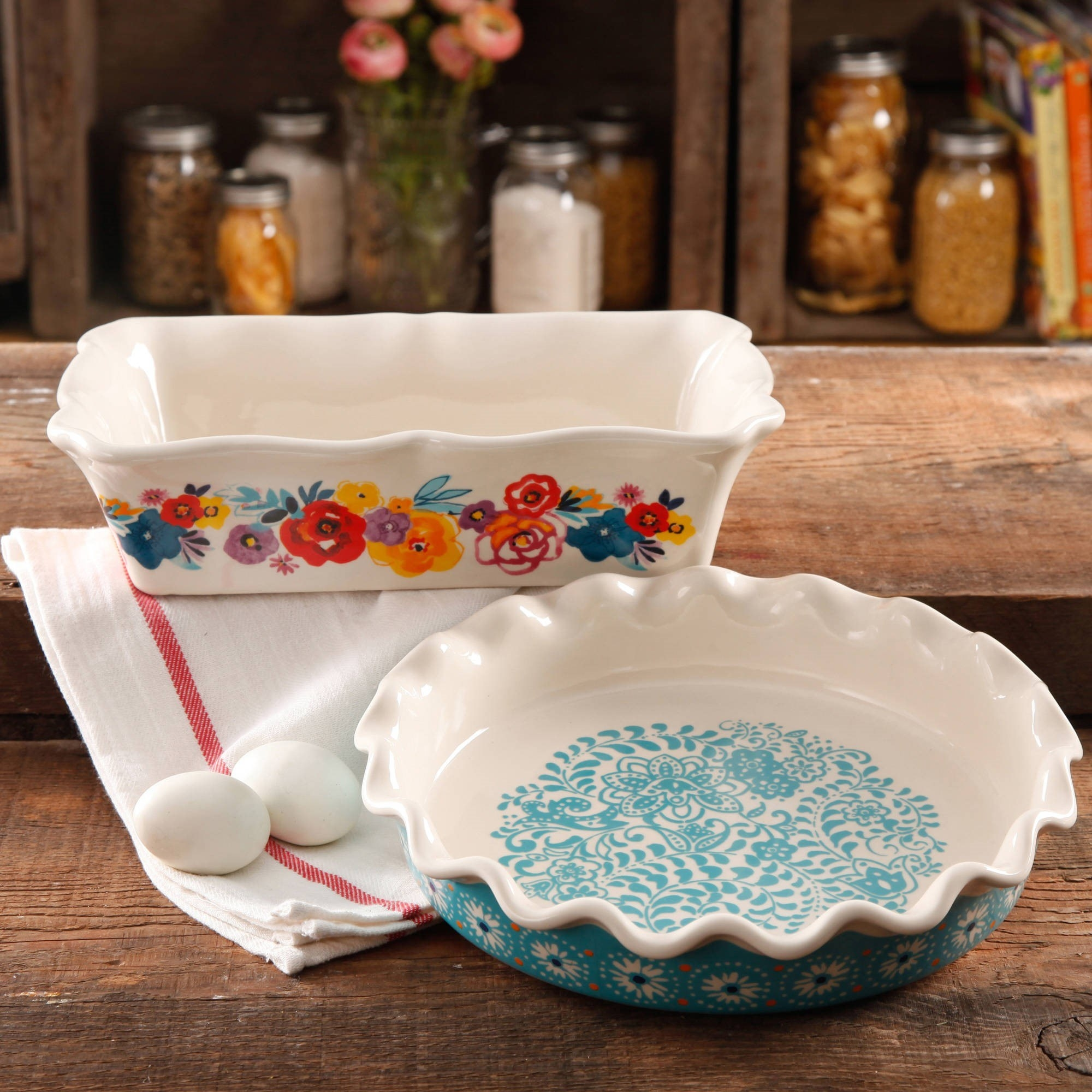 The pie plate and baking dish displayed in a rustic kitchen