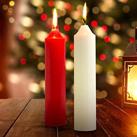 One red and one white EROKAY low temperature candle burn on a wooden table