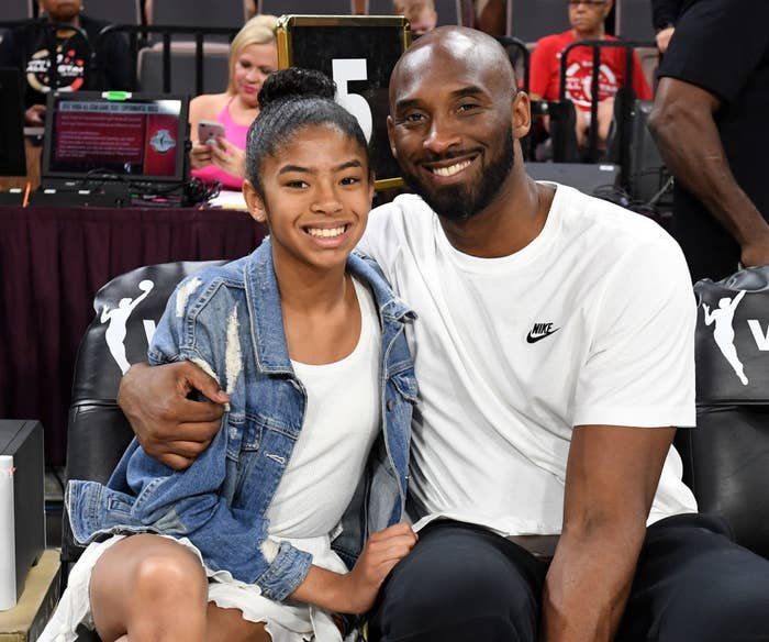 Kobe Bryant smiling and hugging his daughter Gianna