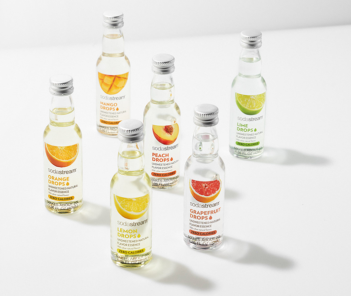 Six small bottles in a variety of different flavors