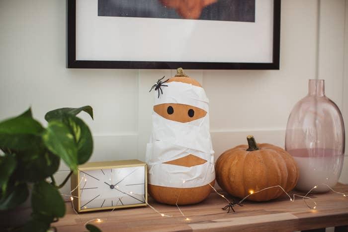 A pumpkin wrapped up like a mummy.