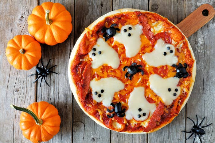 A top-down image of a Halloween themed pizza.