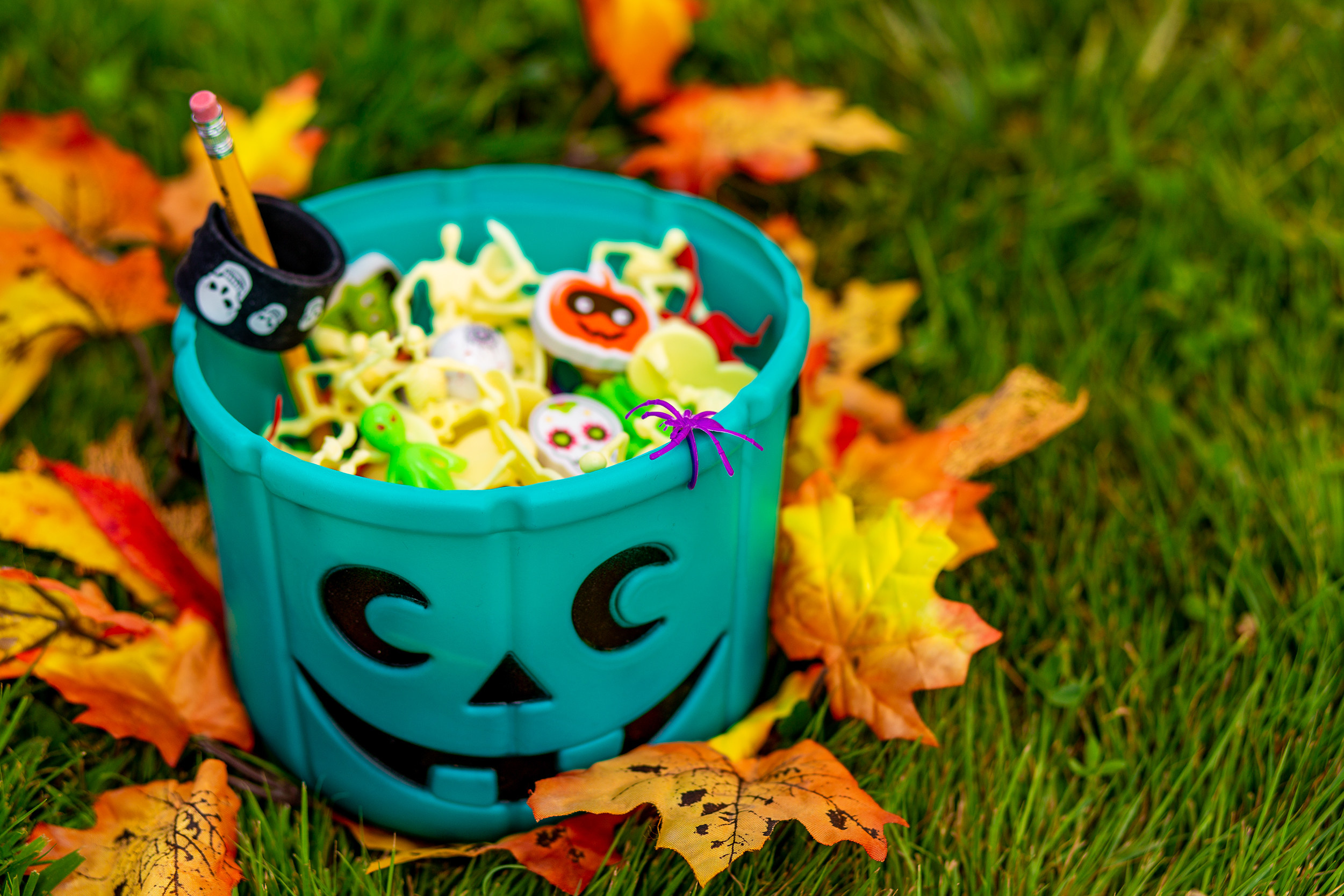 A candy basket filled with Halloween knickknacks.