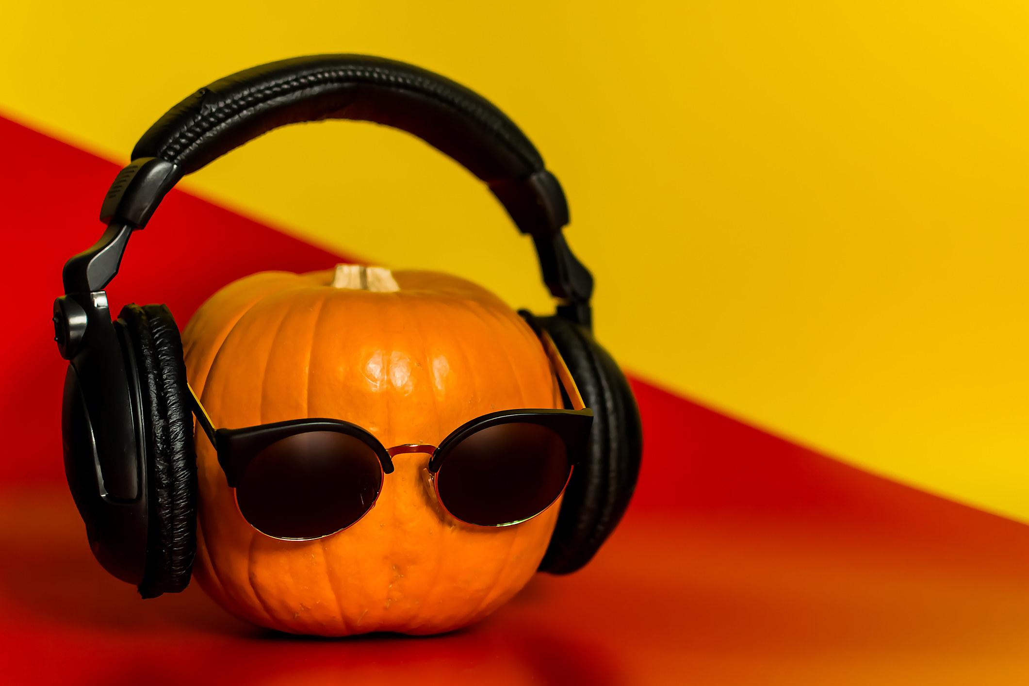 A pumpkin with headphones on.