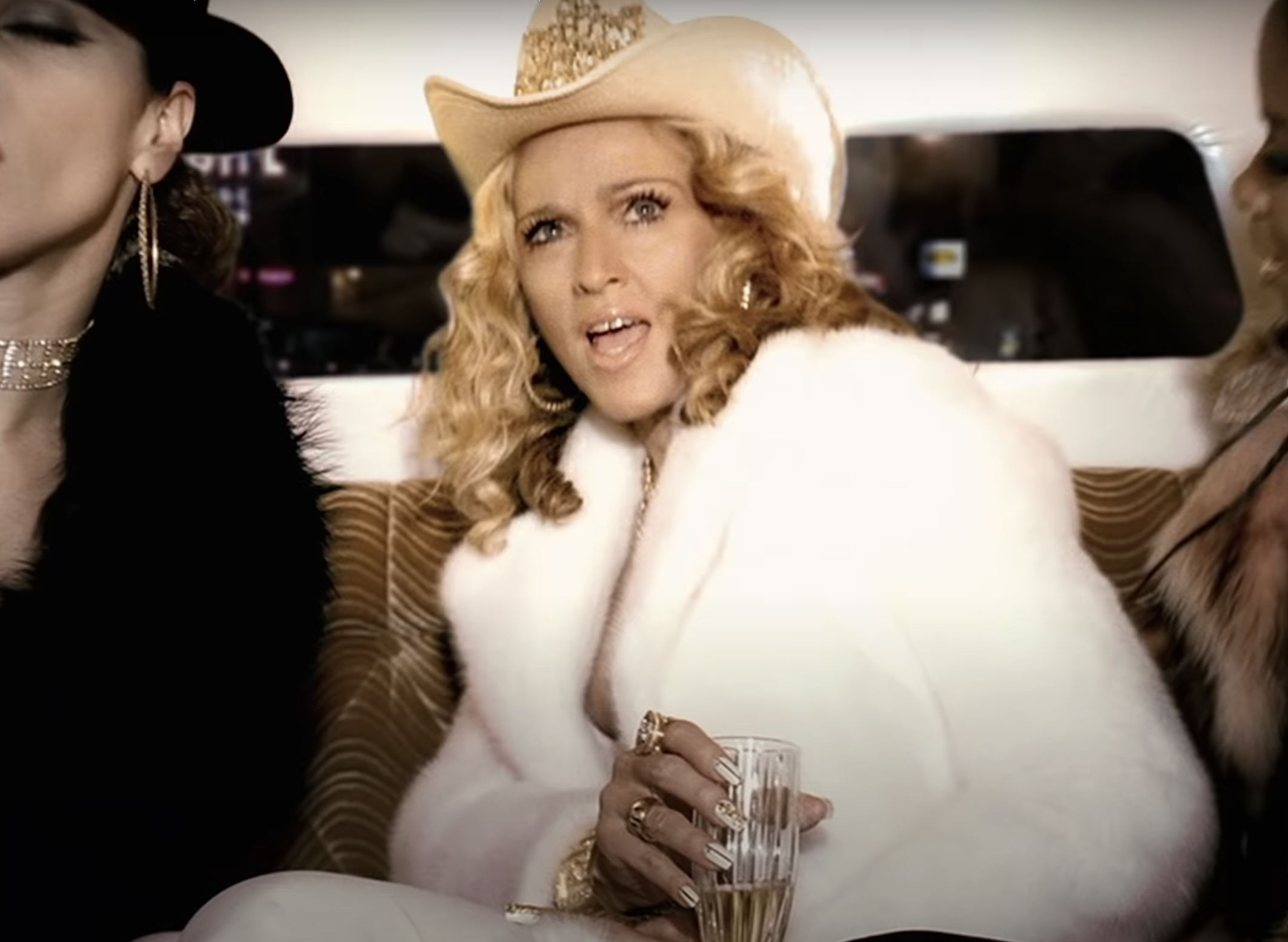 A screenshot of Madonna from the Music music video