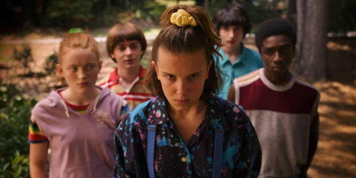 Eleven stands flanked by Max, Will, Mike, and Lucas, looking determined