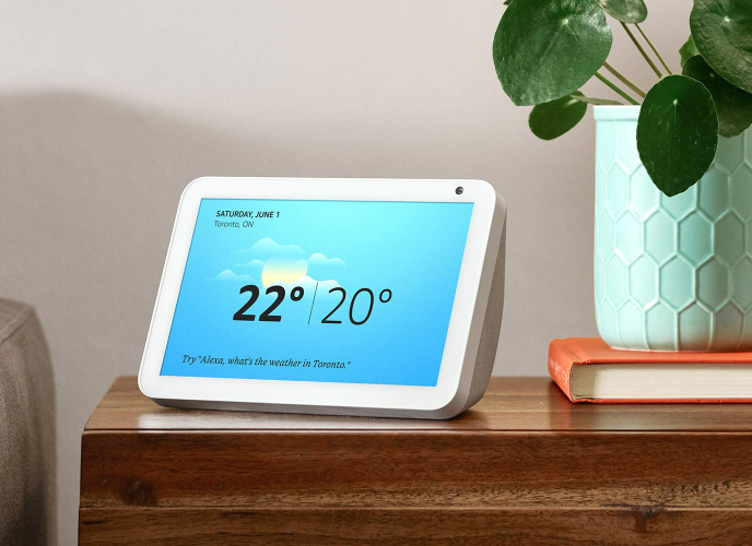 An Echo Show 8 displaying the weather on a night stand