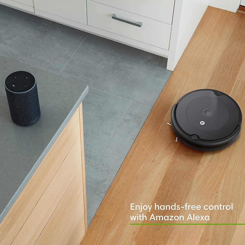 the Roomba vacuum on a hardwood floor