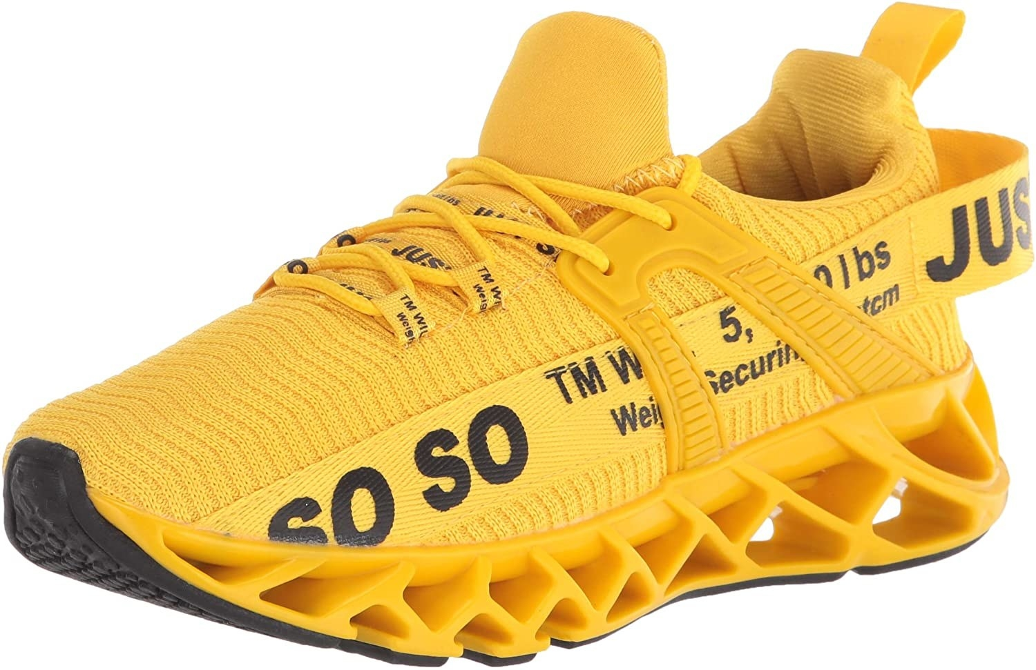 Bright yellow sneaker with words in black and geometric sole