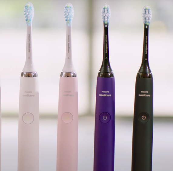 Four toothbrushes lined up