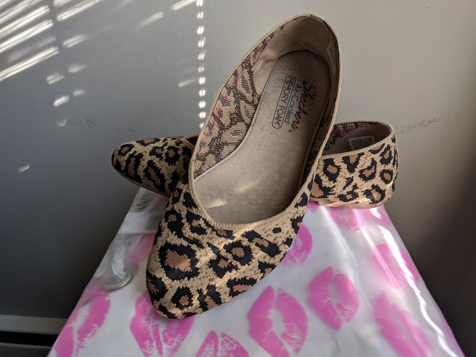 A reviewer image of the brown and black flats