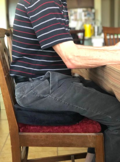 a person sitting on the cushion