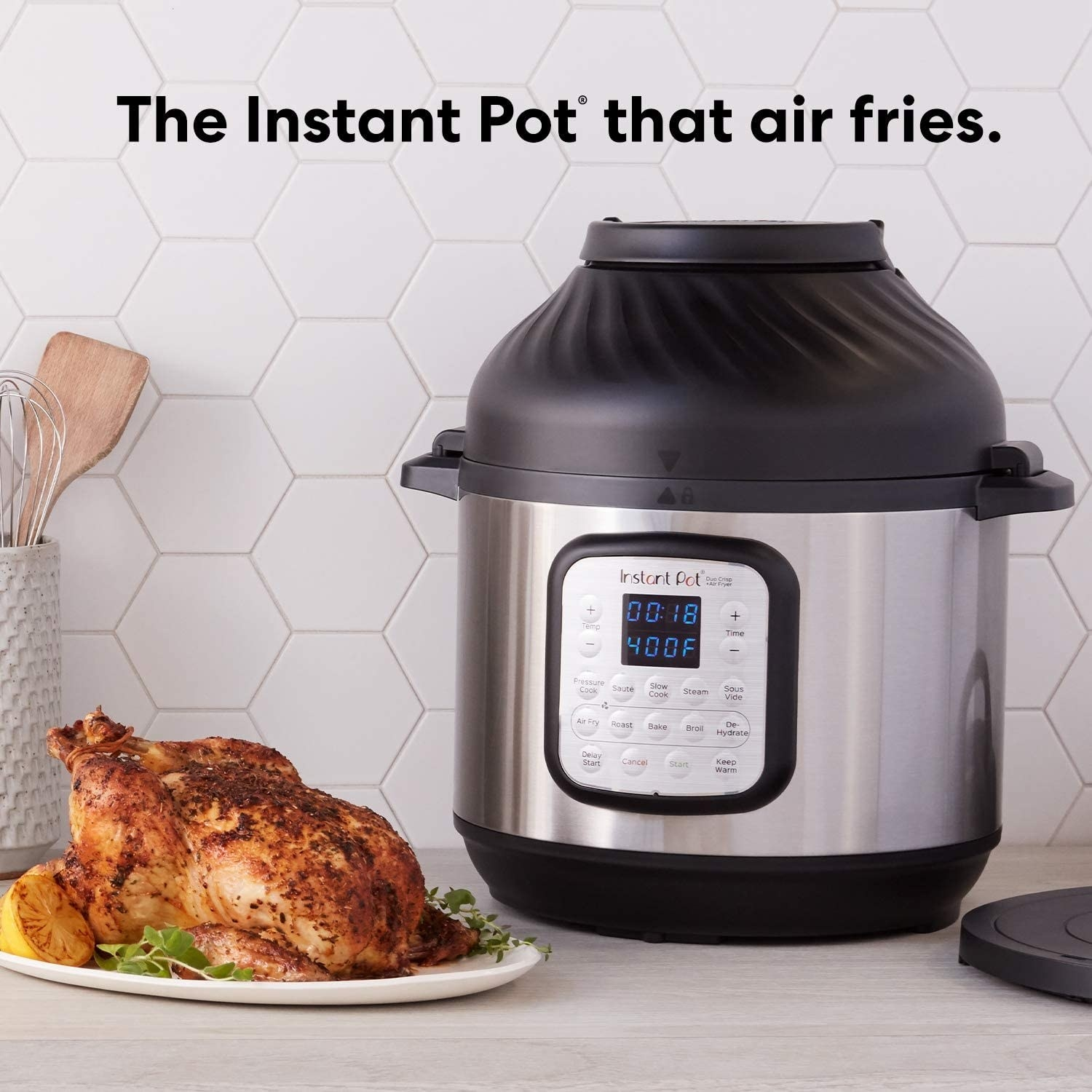 The Instant Pot next to a cooked chicken