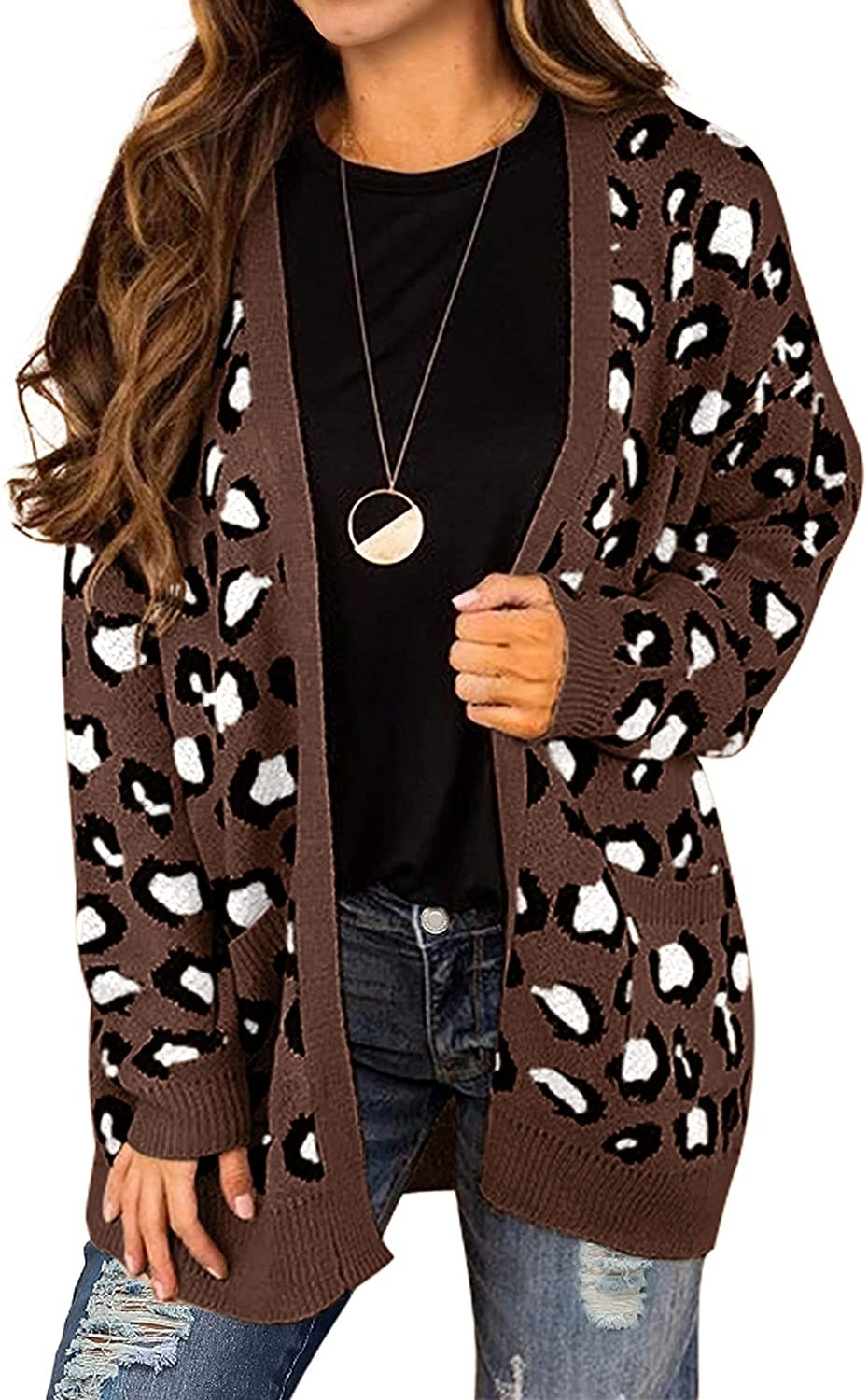 Model in the brown, black, and white leopard print sweater