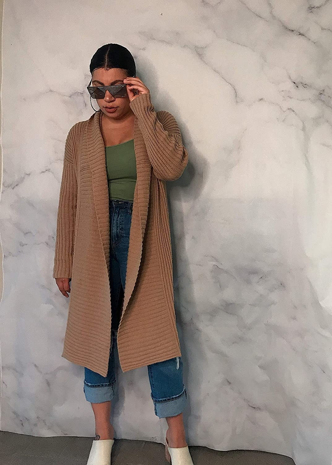 Model in the camel ribbed sweater coat