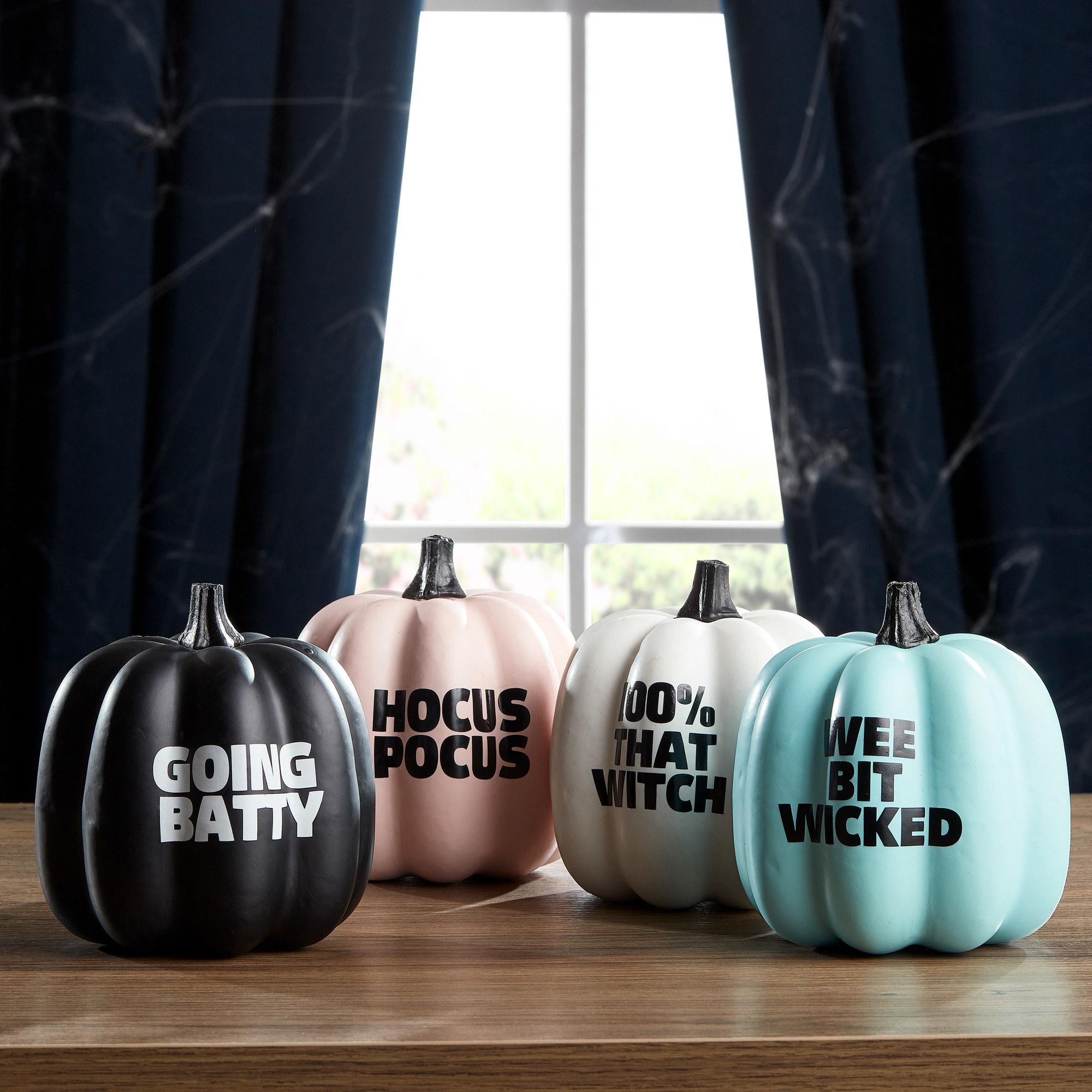 Set of four pastel quote pumpkins