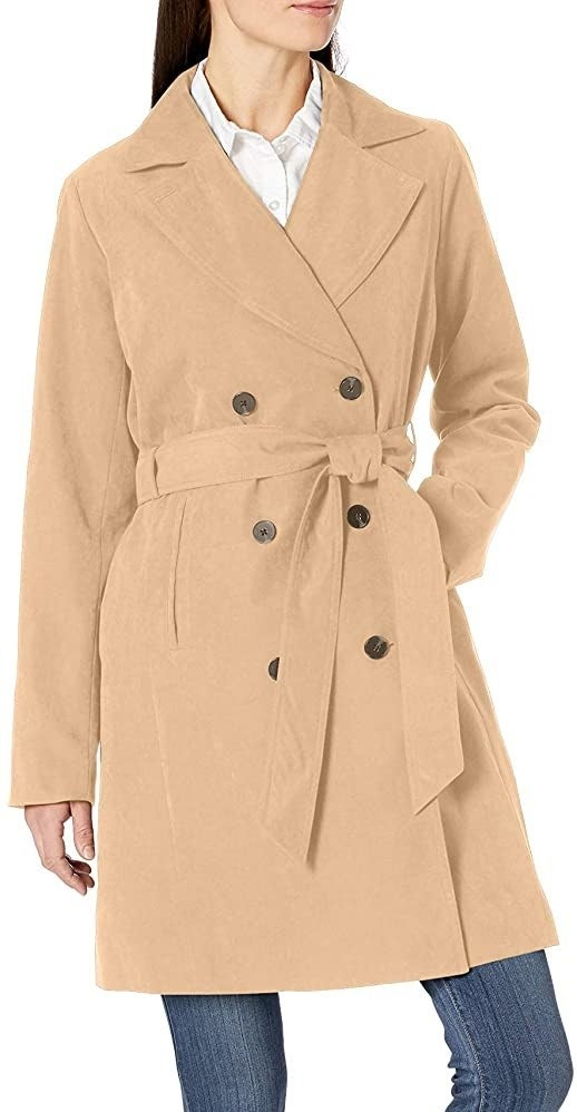 Model in the double-breasted camel trench coat