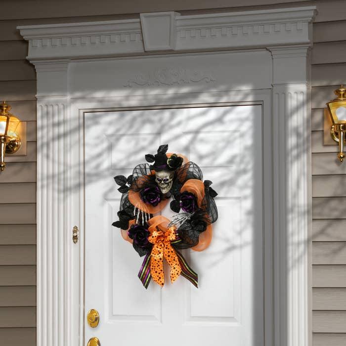 Halloween ribbon wreath on front door