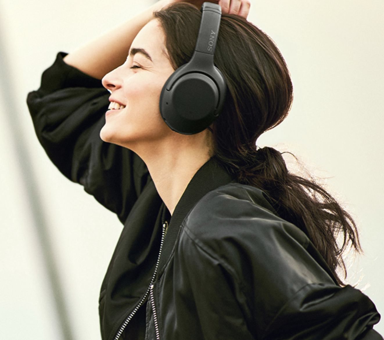 Model in black over the ear headphones