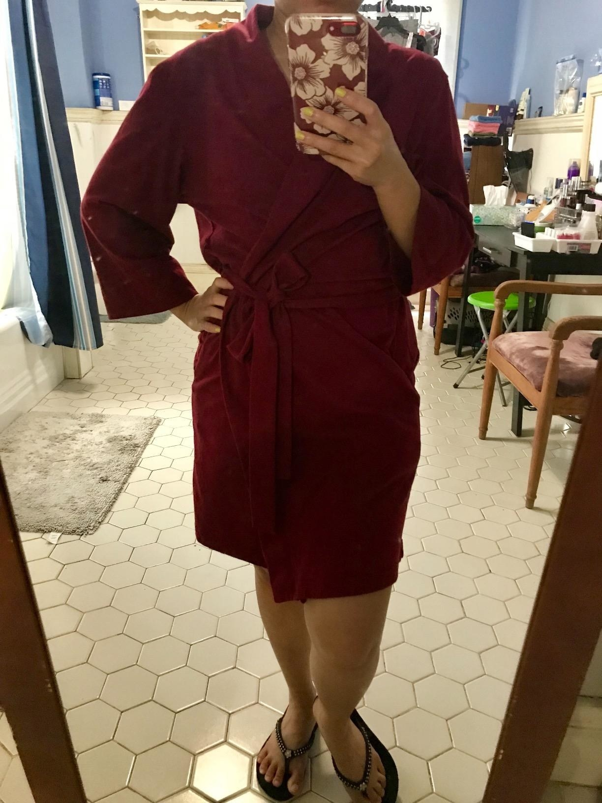 Reviewer wearing the burgundy robe