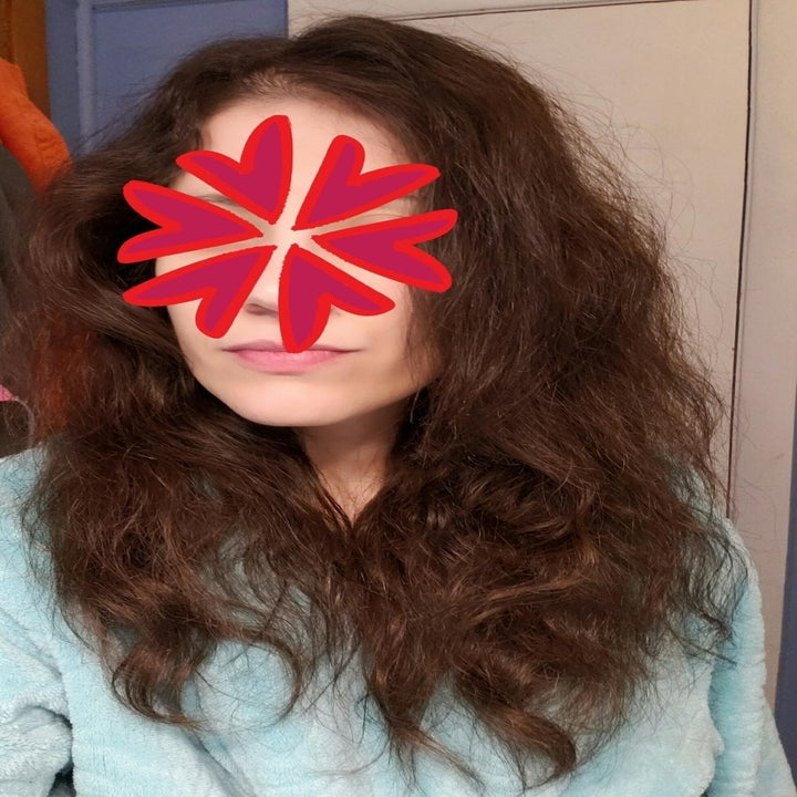 Before photo of reviewer with wavy, frizzy hair