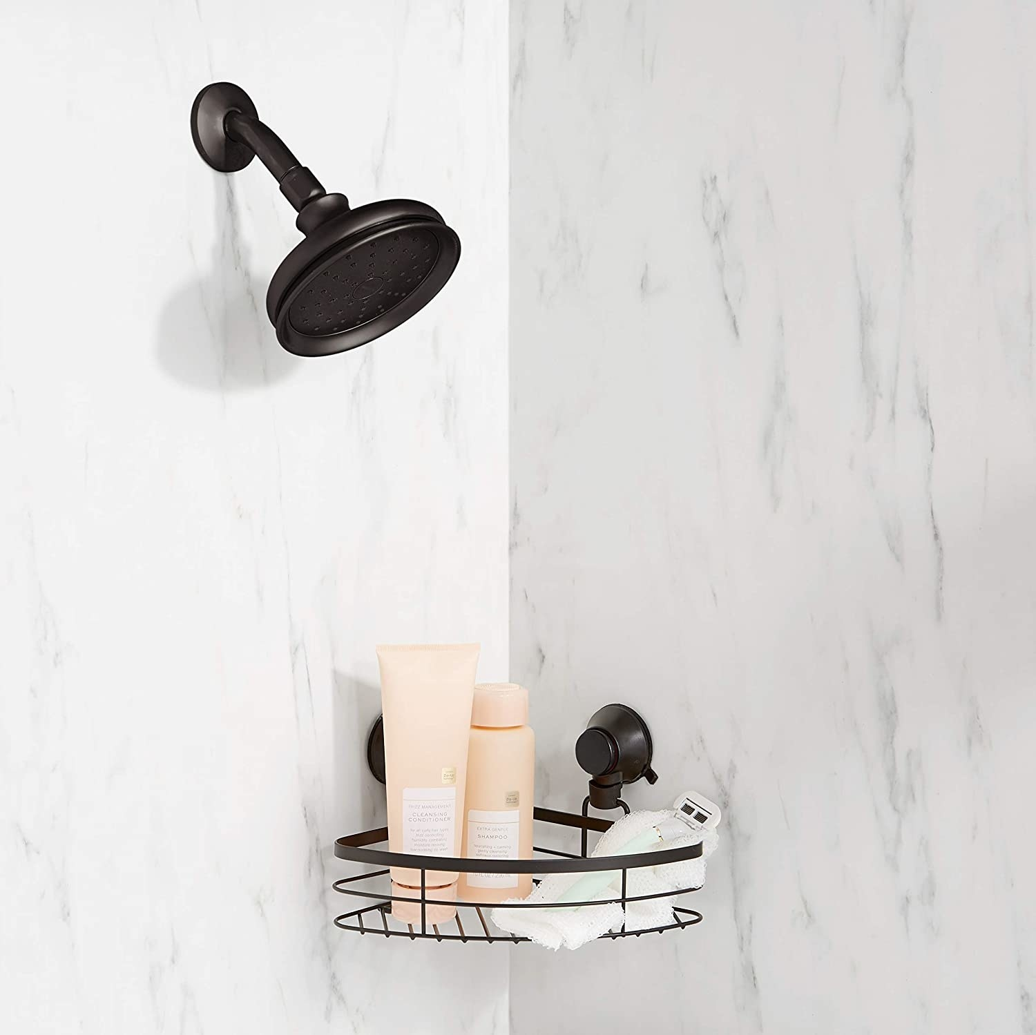 The shower caddy attached to the corner wall of a marble shower