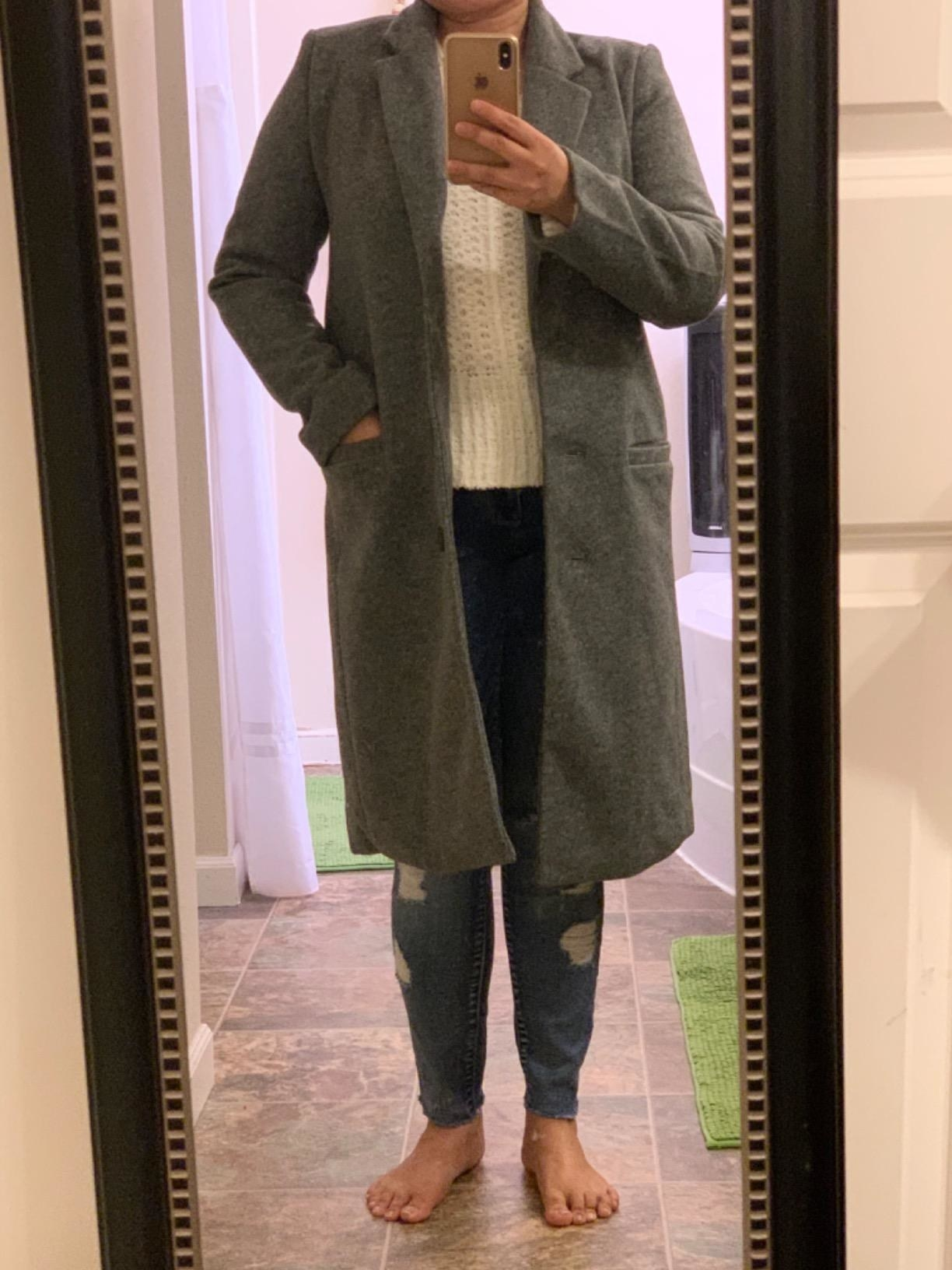 Reviewer in the grey knee-length coat