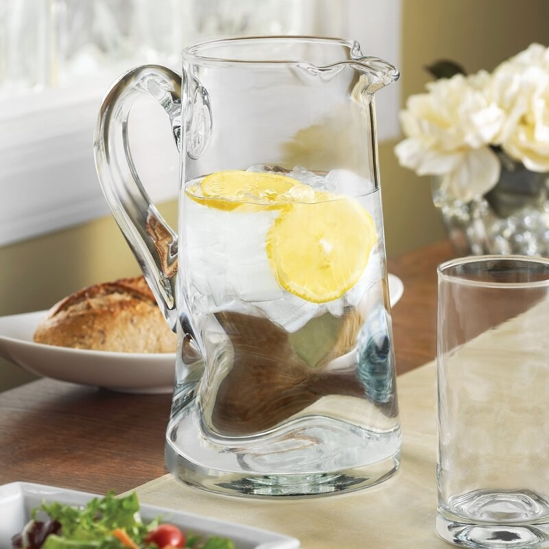 A clear water pitcher