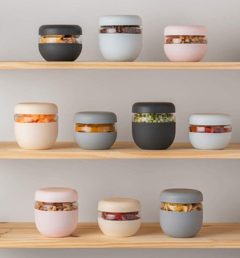 glass bowls with silicone wraps in different colors and sizes on a shelf
