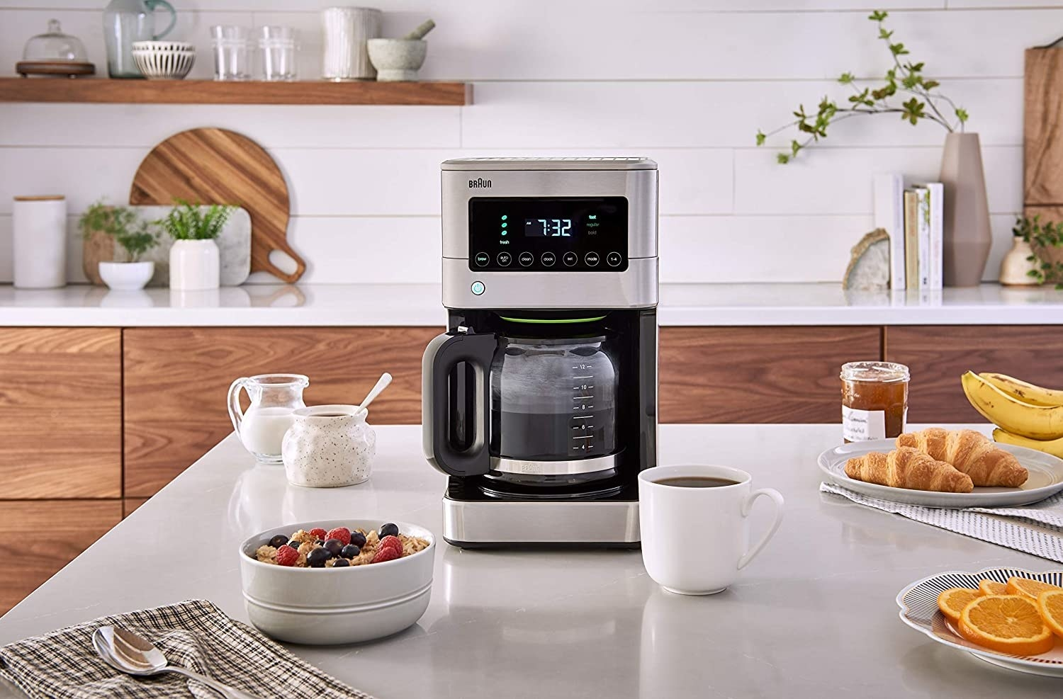 A coffee maker that's brewing coffee in a kitchen