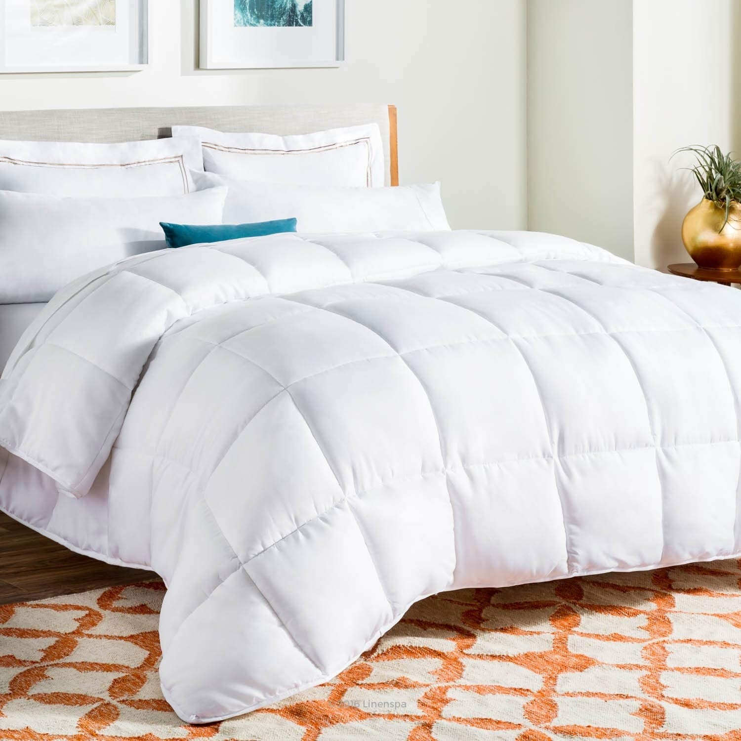 A comforter on a large bed