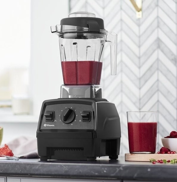 Black Vitamix blender on a kitchen counter